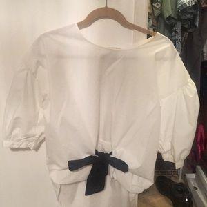 White 100 percent cotton flowy blouse